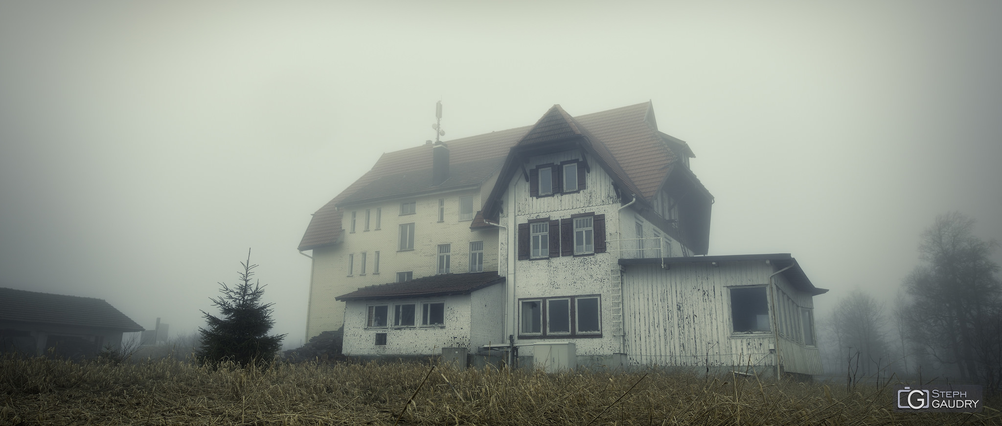 Haunted house in the mist